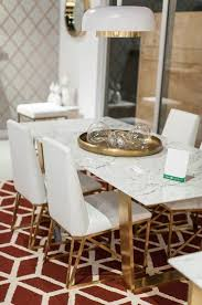 marble and stainless steel dining table a simple yet exquisite white marble dining table with brushed gold