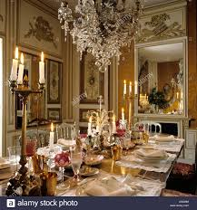 Chandelier Above Dining Table Glass Chandelier Hanging Above Dining Table Set With Candles And