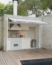abri cuisine ext駻ieure barbecue fixe fonctionnel et esthétique dans le jardin moderne