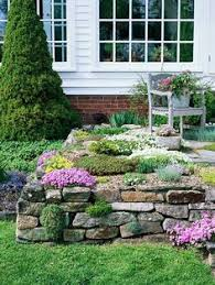 Tiered Backyard Landscaping Ideas Rock Wall With Flowering Plants Rock Retaining Walls Pinterest