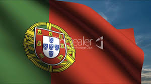 Portugal Football Flag Portuguese Flag Waving In Wind With Clouds In Background Royalty