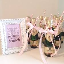 brunch party favors place a mini bottle of chagne on top of an