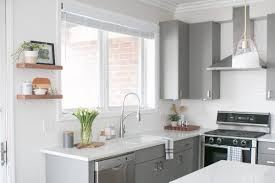 pics of kitchens with white cabinets and gray walls white gray kitchen with brass hardware the diy playbook