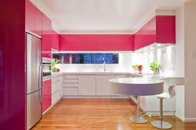 cute and sleek pink modern kitchen with round breakfast nook