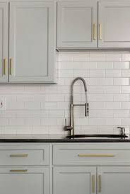 Kitchen Hardware For Cabinets by Gray Cabinets Black Counters Slate Herringbone Floor Marble Hex