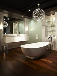 bright bathroom with slate tiles and wooden floating sinks and