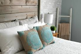 farmhouse style bedroom furniture white accent wall upholstered
