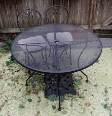 Plantation Patterns Seat Cushions by Round Plantation Patterns Metal Mesh Patio Table And Two Chairs Ebth