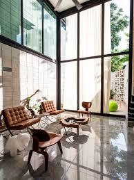 taller estilo installs double height glass doors to concrete