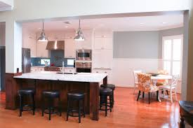 kitchen island with support column contrast dark wood cabinets