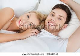 Lovely Couple In Bed Lying In Bedroom Lovely Couple Hugging On Their Bed Stock Photo 110177036