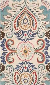 a pop of pattern and a variety of bright colors make this area rug