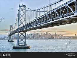 Bay Bridge Lights Sunset Over Oakland San Francisco Bay Bridge And San Francisco