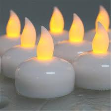 floating led tea lights 12piece amber yellow glow floating led candle light cool white led