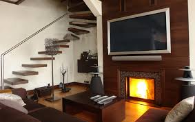 tv mounted over fireplace where to put cable box tv mounted over