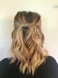 medium length beach waves top pieces knotted and pinned hair