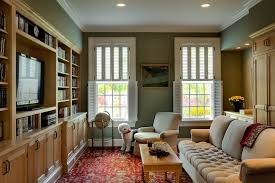 cost of plantation shutters family room traditional with area rug