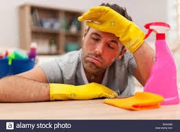 Cleaning The House by Man Tired After Cleaning The House Stock Photo Royalty Free Image