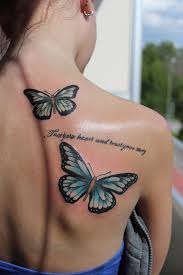butterflies tattoos on leg 25 best butterfly tattoos on back ideas on pinterest black