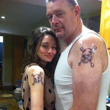 these 11 matching tattoos were made with love for dads and their