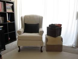 furniture cozy white wingback chair slipcover and fireplace