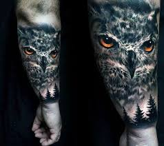 pine trees and owl with orange eyes guys realistic outer forearm