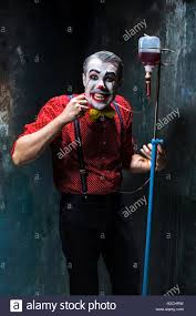 the scary clown and drip with blood on dack background halloween