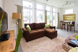 Interior Designs For Apartment Living Rooms Yellow Sofa With Tan Walls Wall Color And Brown Sofas For