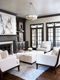 living room with dark wood trim molding taupe built ins flanking