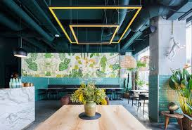 industrial style restaurant with a greenery themed decor