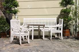 Wooden Patio Furniture White Painted Wooden Patio Furniture Outdoor In A Paved Angle