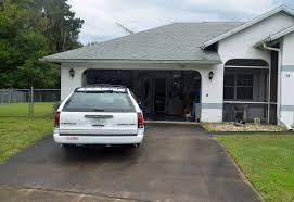 outside car garage garage design ideas station wagon drives through garage and into a house in the