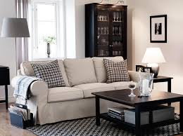 White Sofa Slip Cover by Fancy Modern Coffee Table Design With Gingham Pillows On White