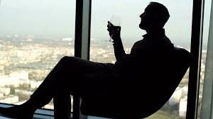 wine silhouette silhouette of man relaxing and drinking wine while sitting on