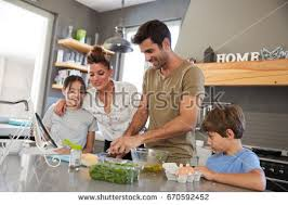 woman loading plates into dishwasher stock photo 165369386