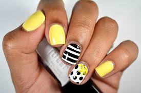diy black and white polkadotted nail art with yellow accent