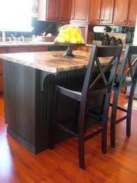 thrifty decor chick beadboard backsplash cozy kitchens loving this island makeover i plan to add beadboard to mine and