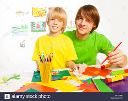 father and son crafting stock photo royalty free image 68258887