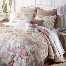 bedroom comfy rose tree bedding with brown pillow and wooden wall