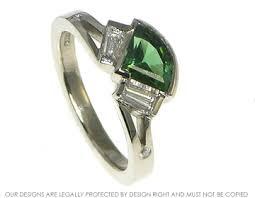 fanshaped art deco inspired0 88ct deep green tourmaline engagement