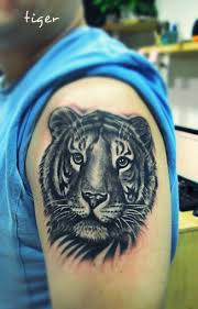 lovely flowers and tiger on arm tattoomagz