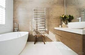 contemporary bathroom addition has timber look tile feature wall