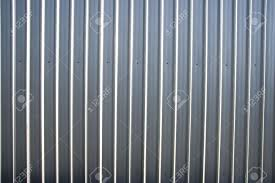 corrugated metal sheet fence with natural grainy texture stock