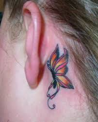 colorful butterfly on left the ear