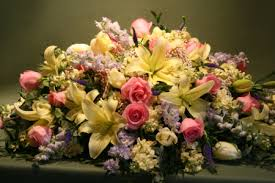 soft pastel casket spray jephry floral studio