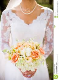 traditional bride with beautiful orange pink and white wedding