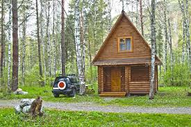 small wooden home architecture in the forest with car part of