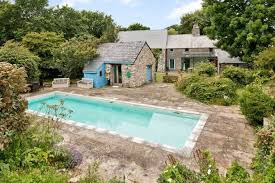 7 welsh properties for sale with swimming pools to cool you off in