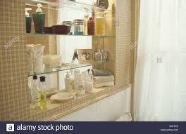 Glass Shelves Bathroom Glass Perfume Bottles And Toiletries On Glass Shelves In Modern