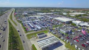 dealerships usa aerial of cars at a dealership parking lot stock footage